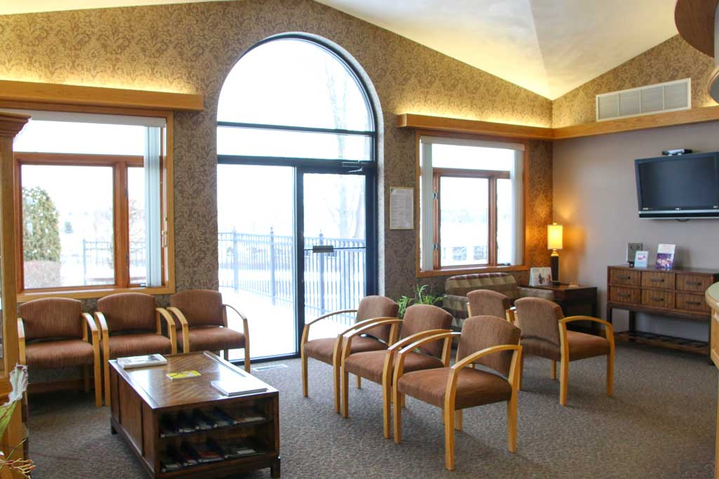 Waiting area and reception desk at Wanserski Dental Center for Complex Dentistry