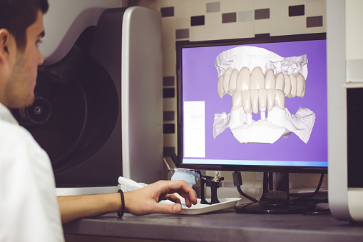 A dental hygienist at Wanserski Dental Center for Complex Dentistry working on 3D imaging system.